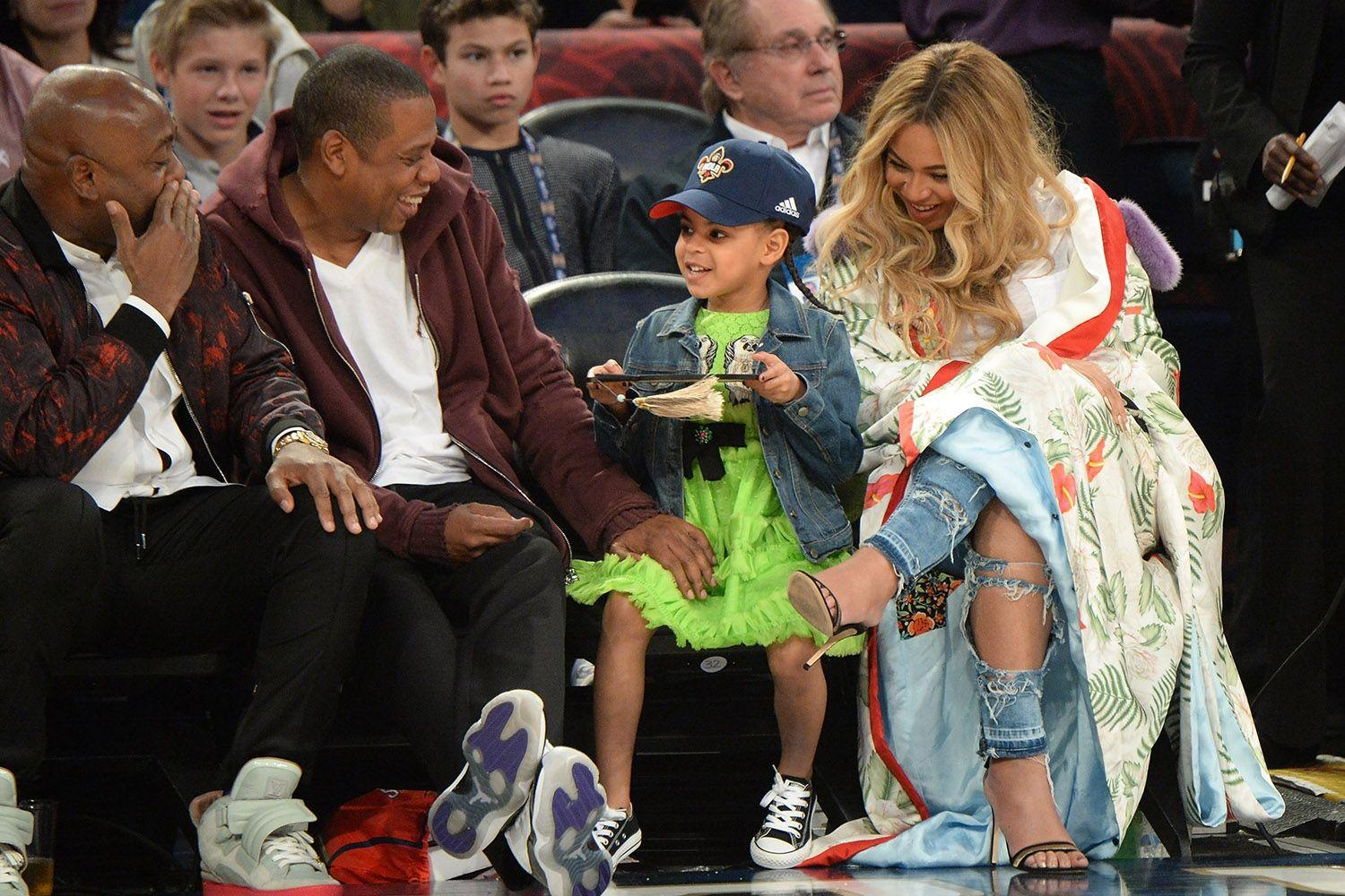 Jay Z, Beyonce and Blue Ivy at the basketball game
