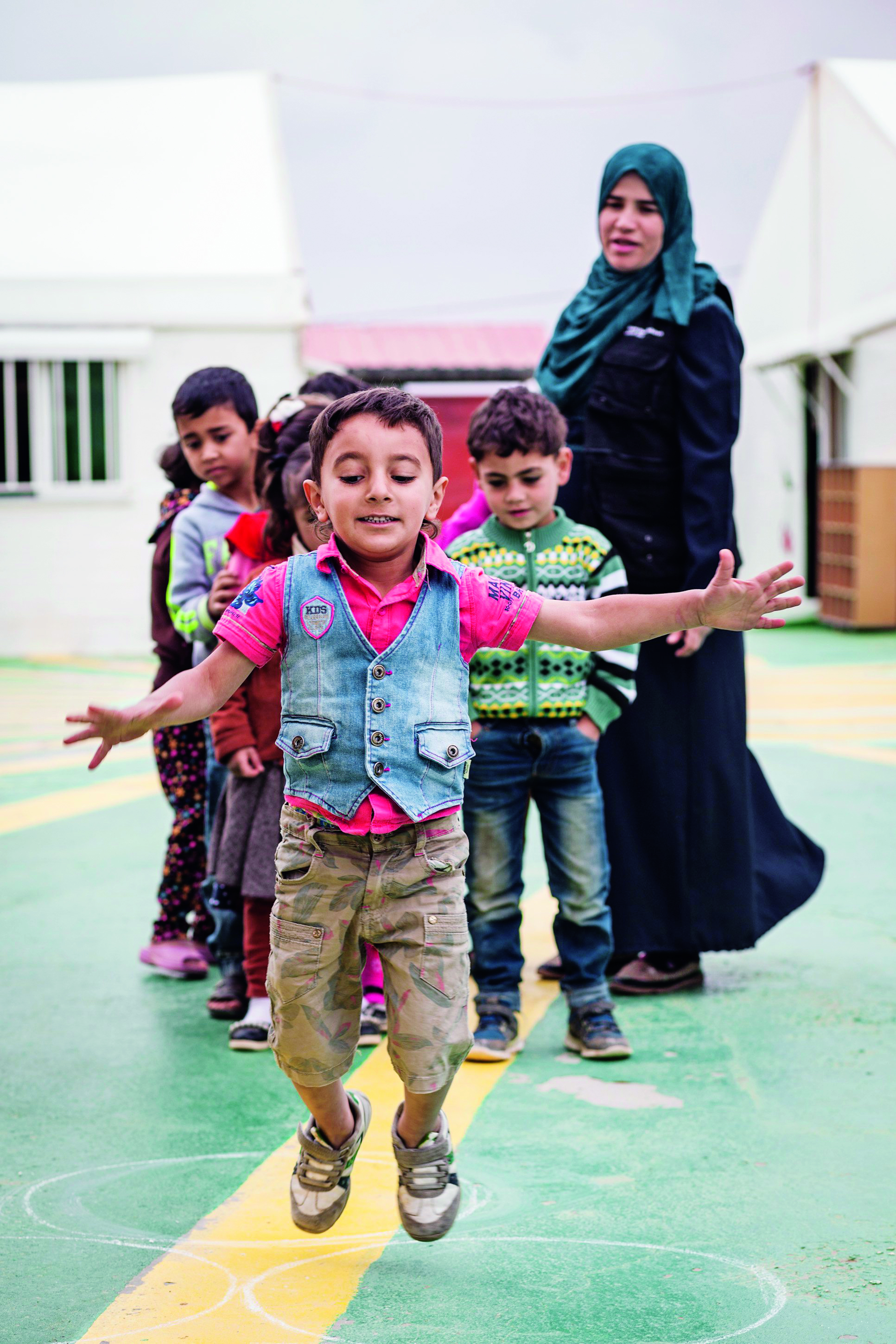 Syrian child refugees playing at a kindergarten run by Save the Children and funded by Bvlgari