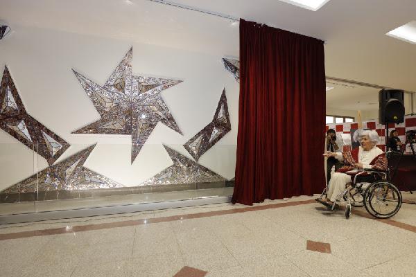 Monir Shahroudy Farmanfarmaian reveals her donated 2014 mirror mosaic work to MAHAK Charity