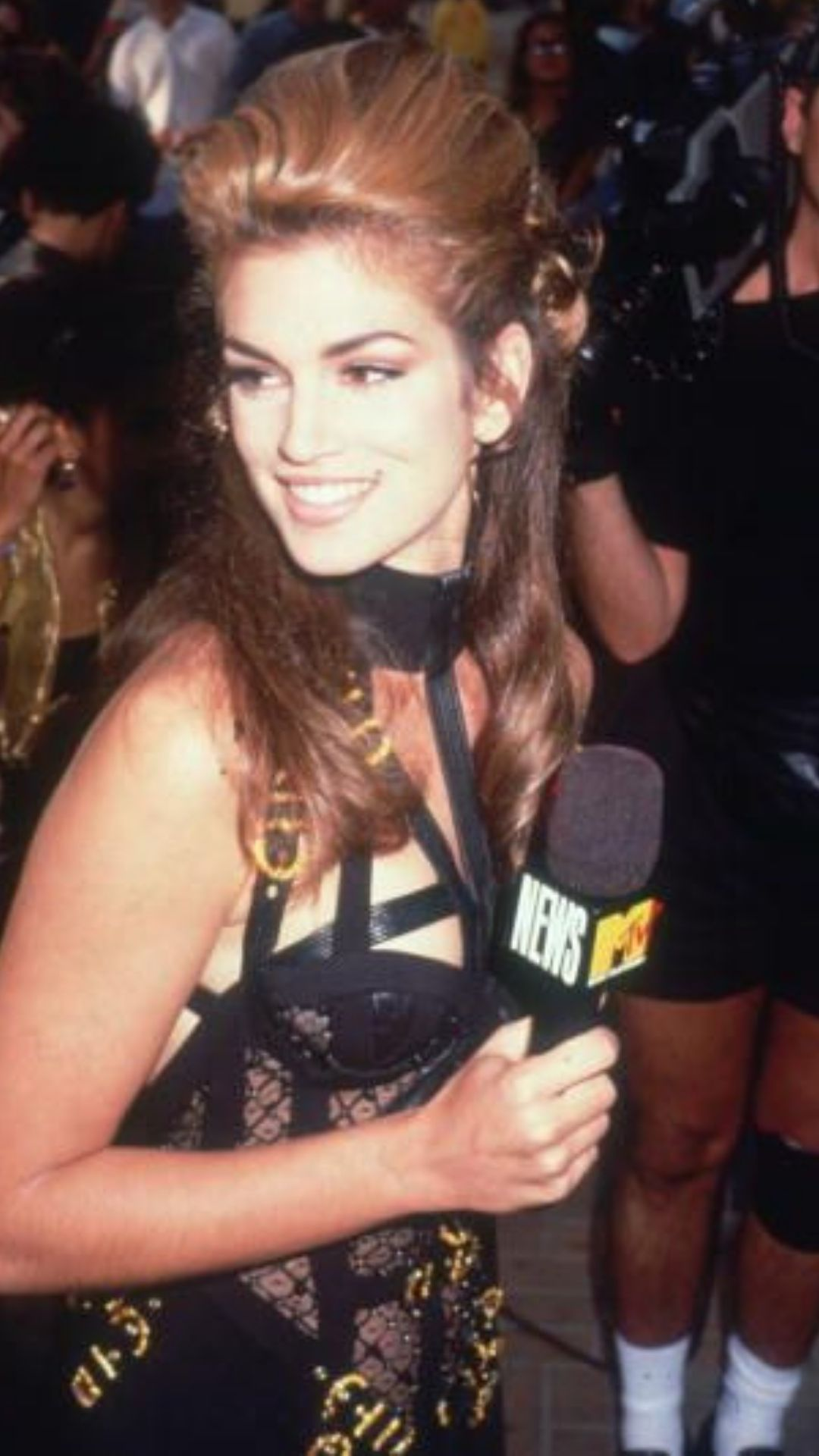American model Cindy Crawford in Versace from the 1990's