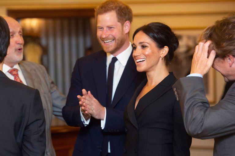 Meghan Wears Chic Tuxedo Dress To Watch Charity Performance Of Hamilton