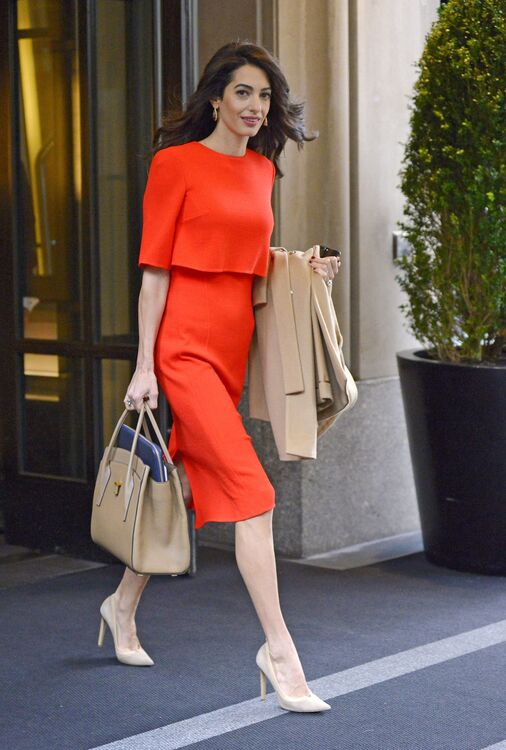 Amal Clooney wearing a powerful red dress