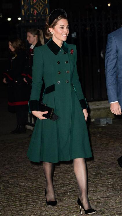 Kate Middleton in a dark green coat