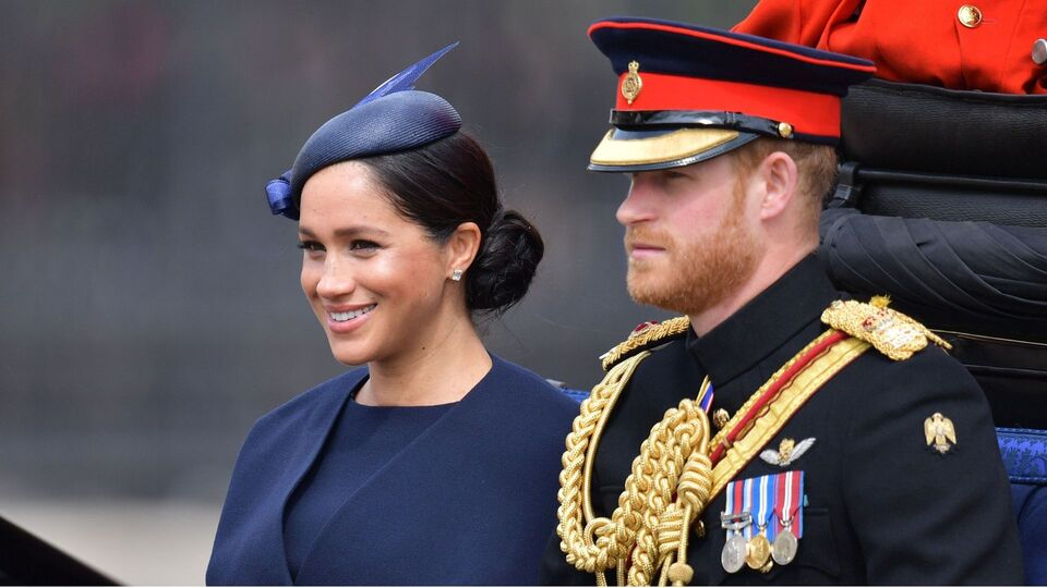The Duchess Of Sussex Returns To Royal Duties In Navy Givenchy Ensemble