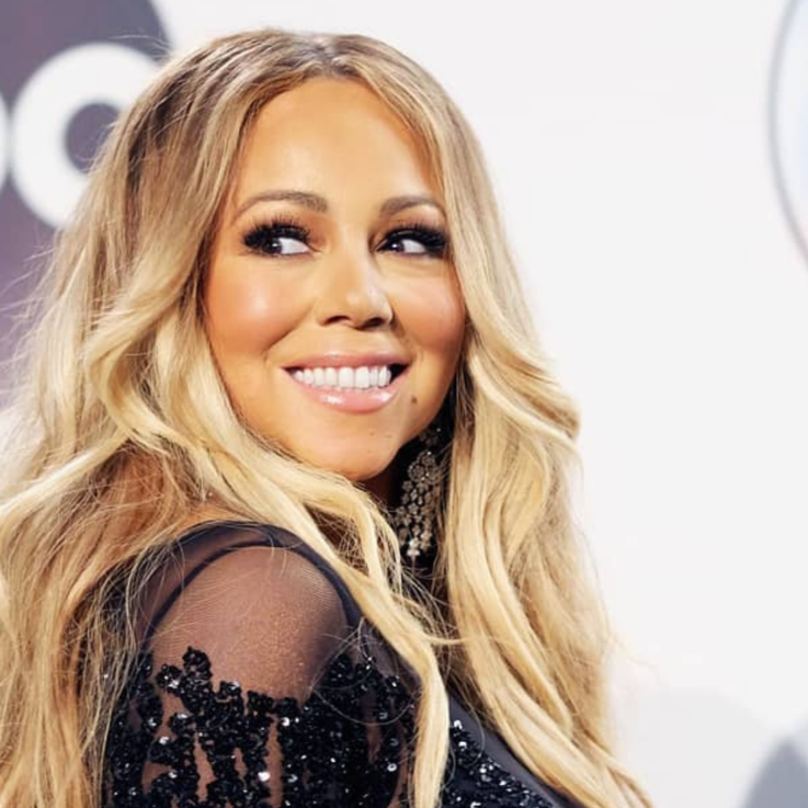 This Kuwaiti Designer Dressed Mariah Carey In A Feather Gown For The AMA's