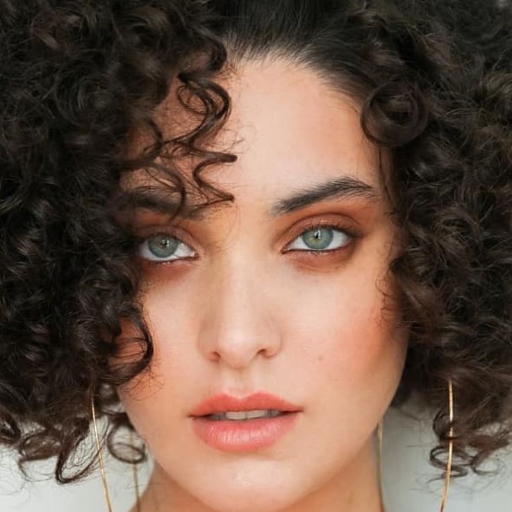 Meet The Tunisian 'Sports Illustrated Swimsuit' Model Who Wants To Change Negative Gender Perceptions In The Arab World