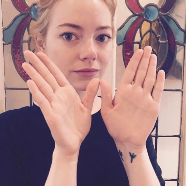Why Celebrities Are All Making The 'W' Sign