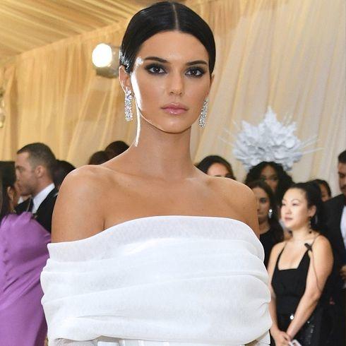 Kendall Jenner Channels Kim Kardashian In An All-White Met Gala Look