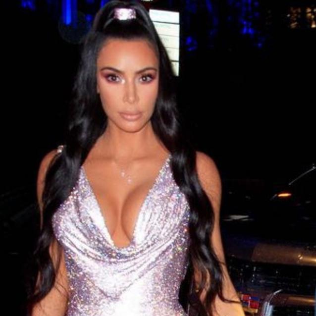 Kim Kardashian's Versace Dress Looks Just Like Paris Hilton's 21st Birthday Look