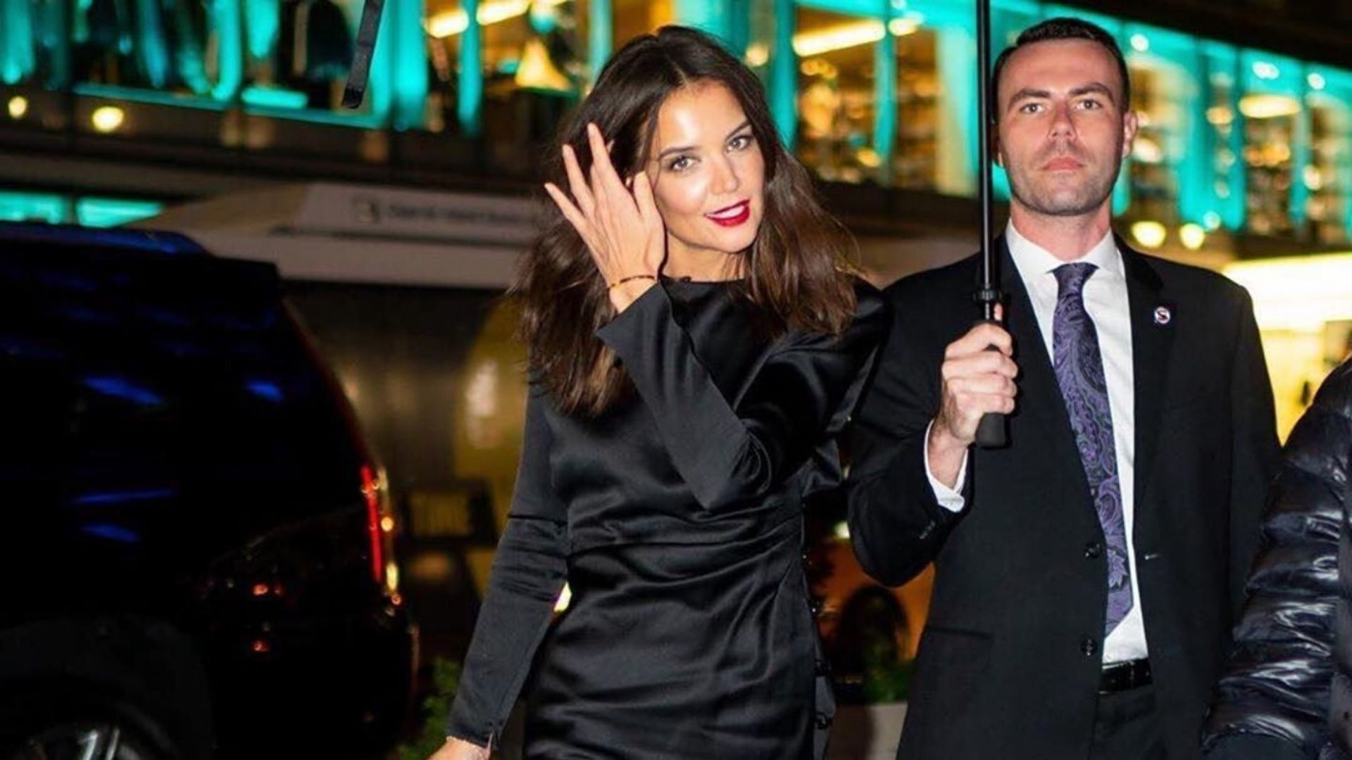 Katie Holmes Braved The Rain In A Little Black Dress And Sheer Tights