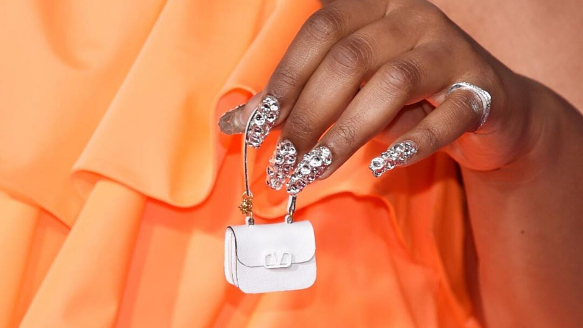5 Tiny Things You Could Fit In Lizzo's Tiny Bag
