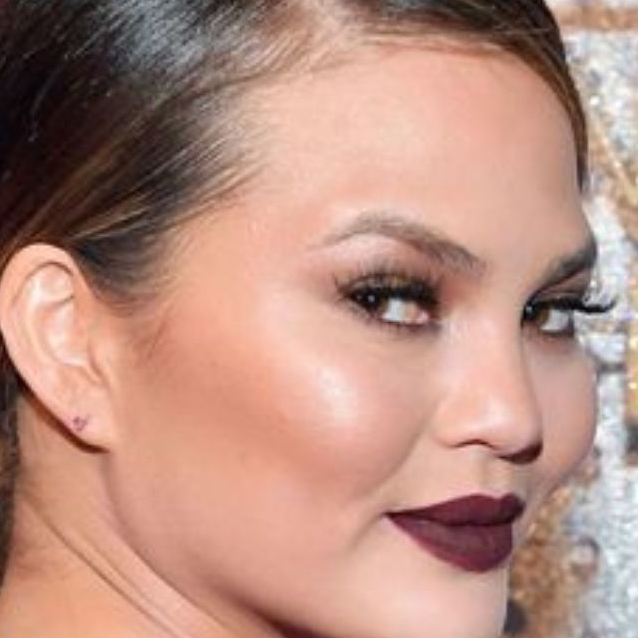 How To Escape Long Lines At The Airport Like A Pro, According To Chrissy Teigen
