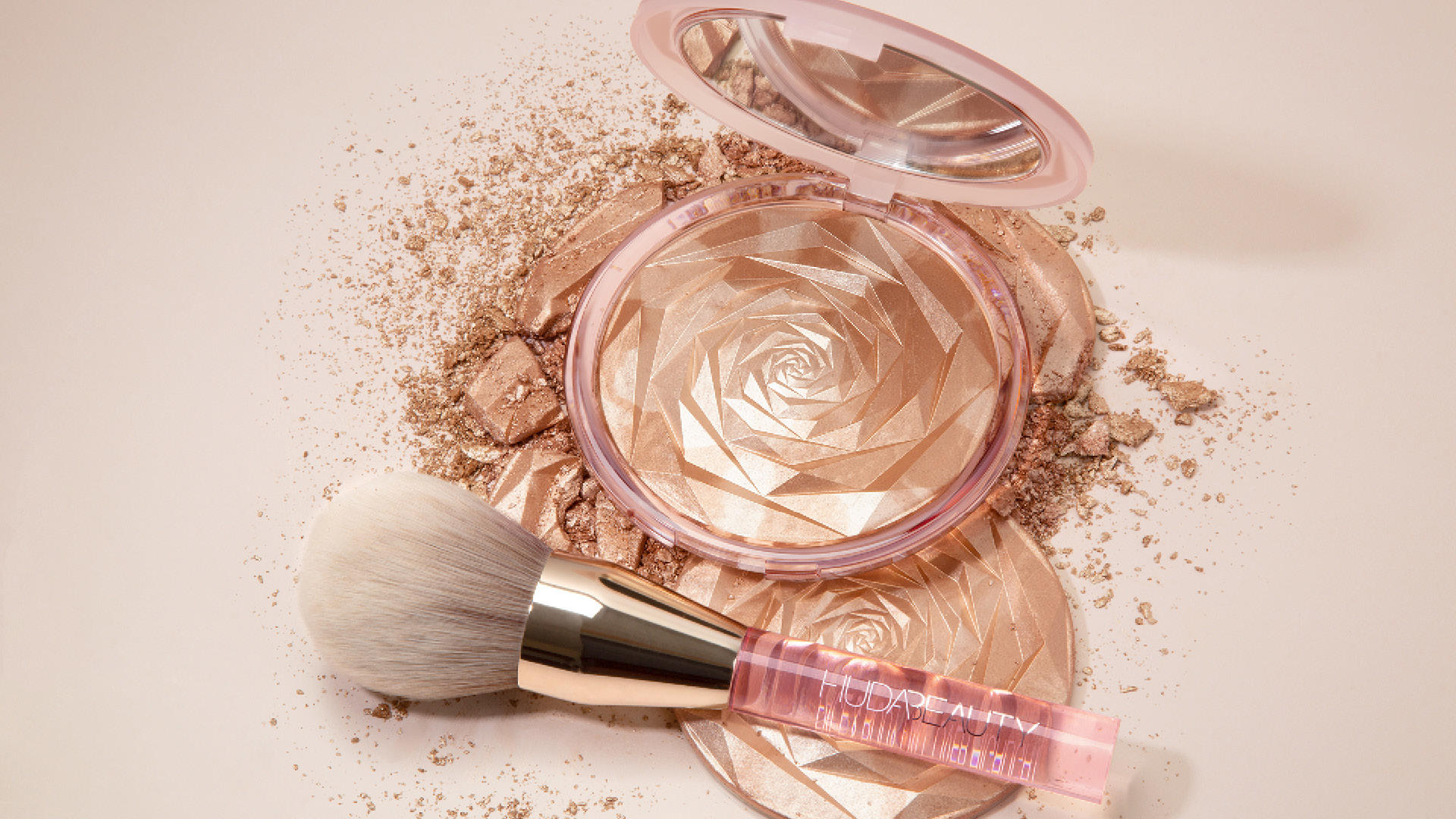 Get That Perfect Summer Glow With Huda Beauty's New N.Y.M.P.H All-Over Highlighting Powder